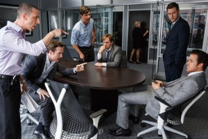 Left to right: Jeremy Strong plays Vinny Peters, Rafe Spall plays Danny Moses, Hamish Linklater plays Porter Collins, Steve Carell plays Mark Baum, Jeffry Griffin plays Chris and Ryan Gosling plays Jared Vennett in The Big Short from Paramount Pictures and Regency Enterprises